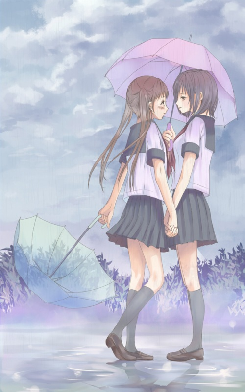 hand holding beneath an umbrella